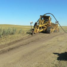 "Plowing 4"" pipe through some scrub brush"